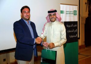 Luigi Wewege receiving a thank you gift from the Kuwait Finance House, Bahrain MD & CEO Mr. Abdulhakeem Alkhayyat
